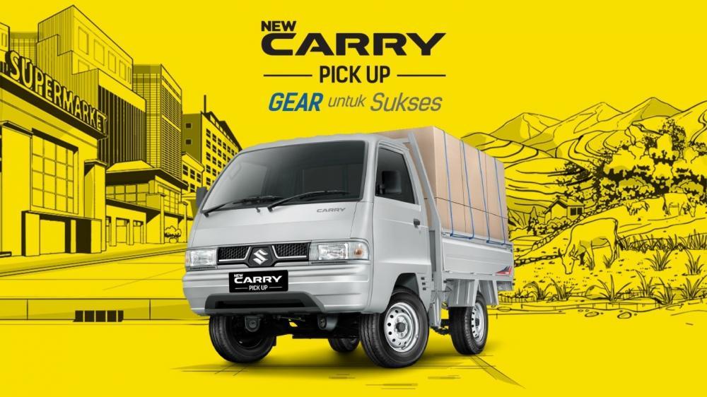 Gambar mobil Suzuki Carry Pick Up berwarna putih dilihat dari sisi depan